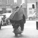Bassist Bill Crow (USA) traveling with his bass on his Lambretta.